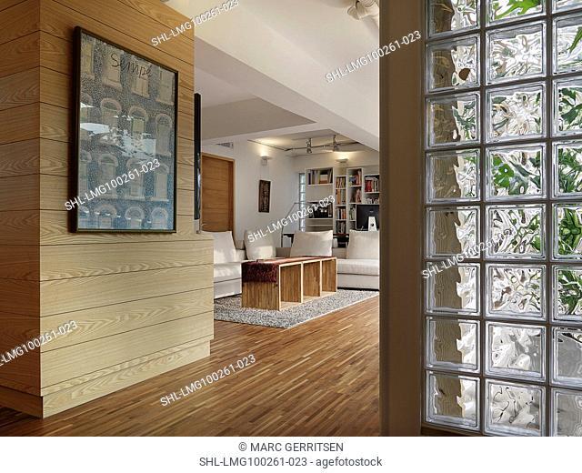 Glass block detail and hardwood floors in modern home