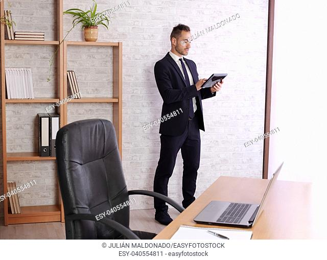 Businessman observing statistics on a tablet