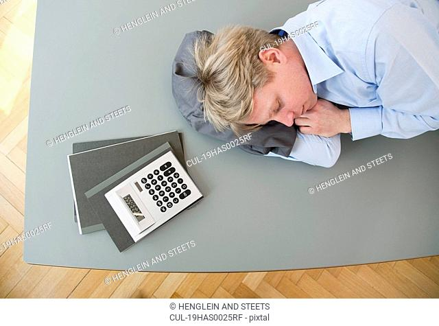 Businessman sleeping on conference table