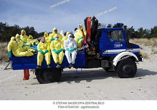 Members of staff of the 'Technische Hilfswerk, THW', the German federal Agency for Technical Relief, sit on the back of a THW truck on their way to the area of...