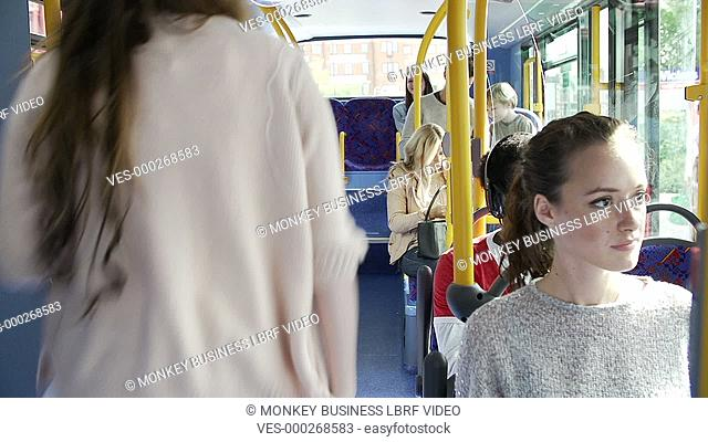 Interior of crowded bus with passengers getting on at stop.Shot on Sony FS700 in PAL format at a frame rate of 25fps