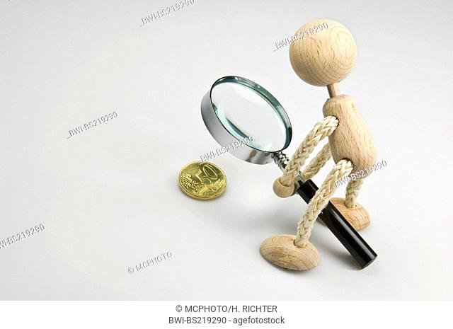 figur examining 50 Euro Cent with a magnifying glass