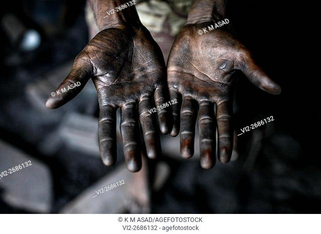 Portrait of a hard worker's hands in Dhaka, Bangladesh June 17, 2015. Life is very hard in the shipyard