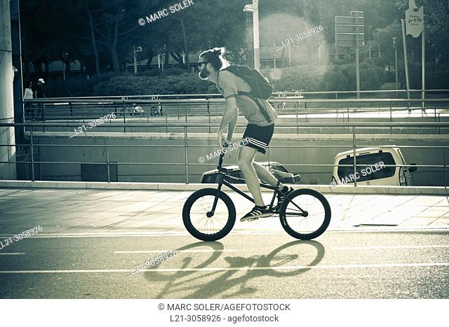 Young man riding a BMX bicycle style. Barcelona, Catalonia, Spain