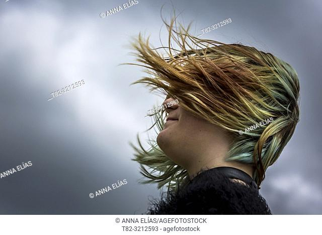 face teen woman with hair flying over stormy sky, Cadiz, Andalucia, Spain, Europe