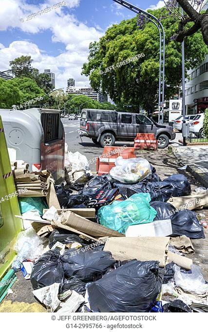 Argentina, Buenos Aires, Palermo, Plaza Italia, trash bin, plastic trash bags, dumping, Argentinean Argentinian Argentine
