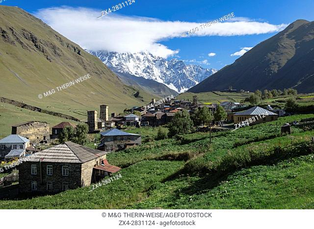 Traditional medieval Svanetian tower houses, Ushguli village, Shkhara Moutains behind, Svaneti region, Georgia, Caucasus, Middle East, Asia