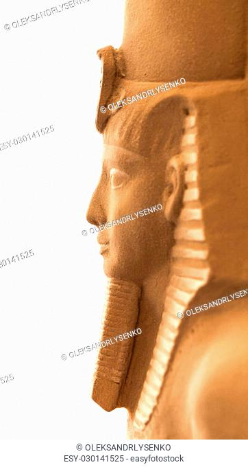 sculpture Egyptian pharaoh made of sandstone closeup
