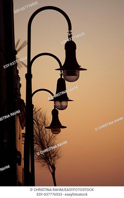 Retro streetlights and evening golden sky mood background