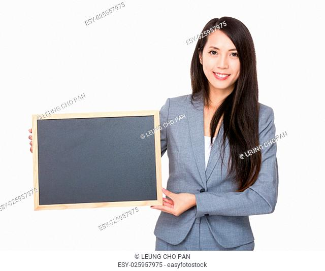 Young Businesswoman showing with the blank chalkboard