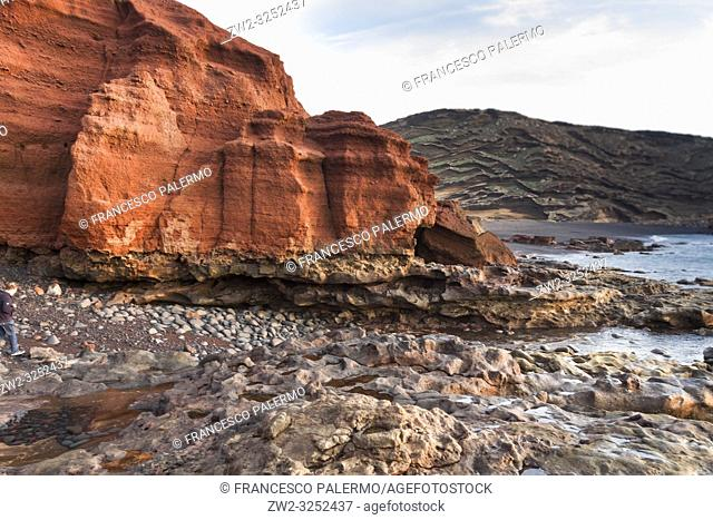 The eroded rocky levels of the volcanic red mountain. El Golfo, Lanzarote. Spain