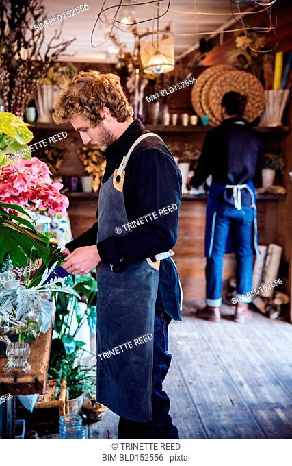 Florists working in shop