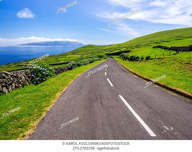 Portugal, Azores, Corvo, Road leading to Caldeirao and Flores Island on the horizon
