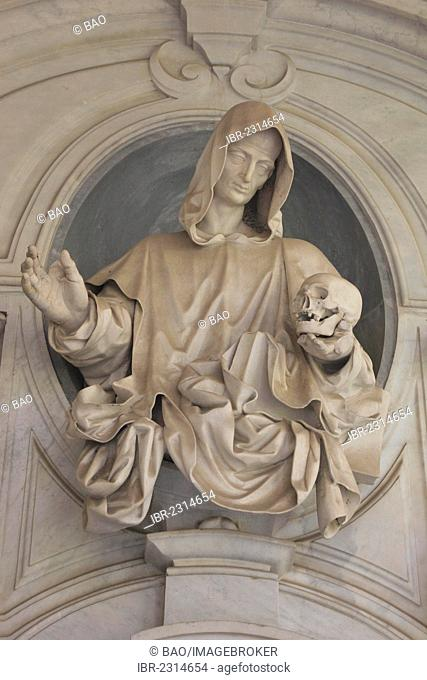 Statue of a monk holding a skull on the monastic cemetery, in the big cloister of the Certosa di San Martino monastery, Vomero district above Naples, Campania