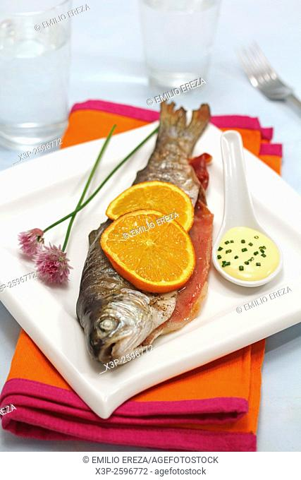 Stuffed trout with ham and orange