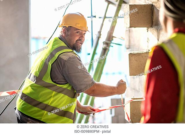 Construction workers on building site