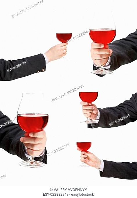set of red wine glass in businessman hand