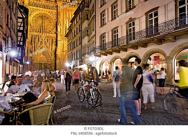 People in an alley, Strasbourg Cathedral in the background, Strasbourg, France