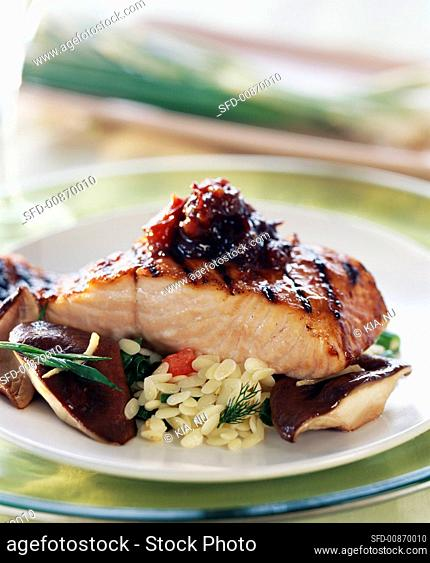 Grilled salmon fillet with plum & ginger sauce & vegetables