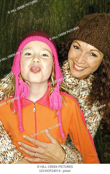 Mother and daughter in winter hats