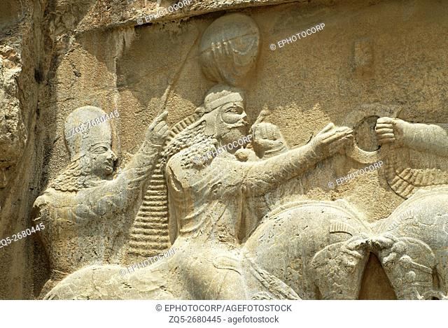 Naqsh e Rustam, King with attendant in low relief, an archaeological site located about 12 km northwest of Persepolis, in Fars province, Iran