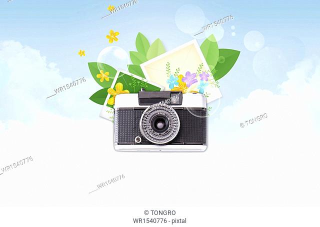 a camera next to a couple of pictures