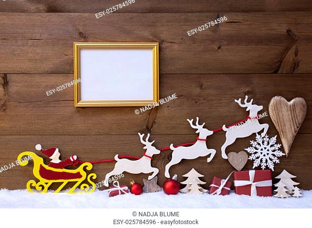 Christmas Decoration, Red Santa Claus, Yellow Sled And Reindeer On White Snow. Gift, Present, Christmas Tree, Ball, Snowflakes, Heart, Picture Frame