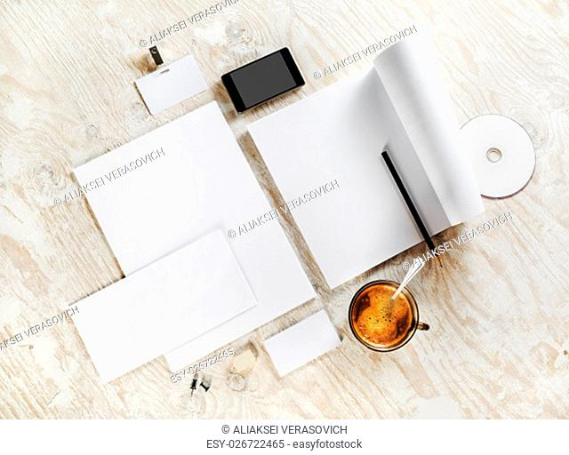 Photo of blank stationery. Corporate identity template on light wooden background. For design presentations and portfolios. Top view