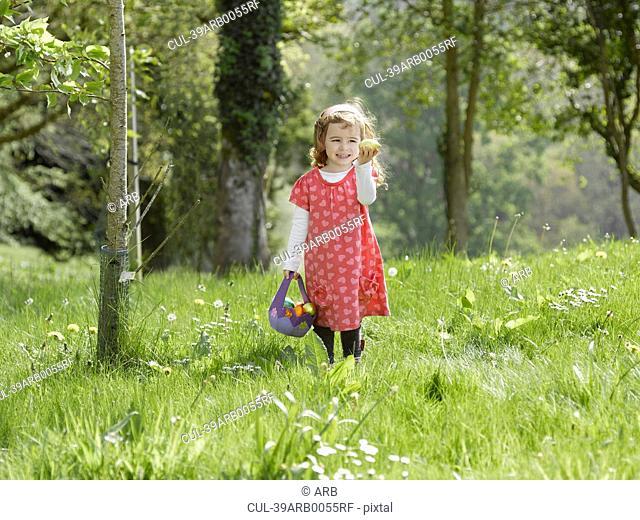 Girl hunting for Easter eggs