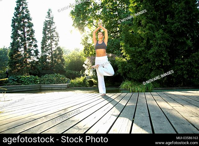 Woman doing yoga in a garden