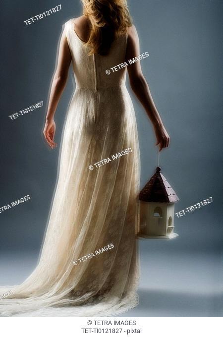 Woman wearing a long white dress