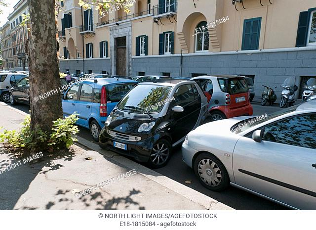 Europe, Italy, Rome  Smart Car squeezed sideways into parking spot