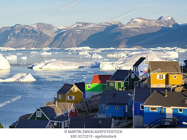 The town Uummannaq in the north of West Greenland, located on an island in the Uummannaq Fjord System, in background the Nuussuaq (Nugssuaq) Peninsula