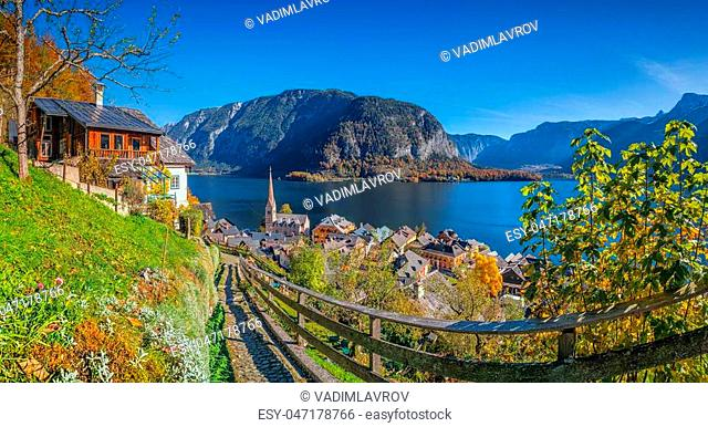 Scenic picture-postcard view of idyllic Hallstatt mountain village with famous lake Hallstatter See in the Austrian Alps on a beautiful sunny day with blue sky...