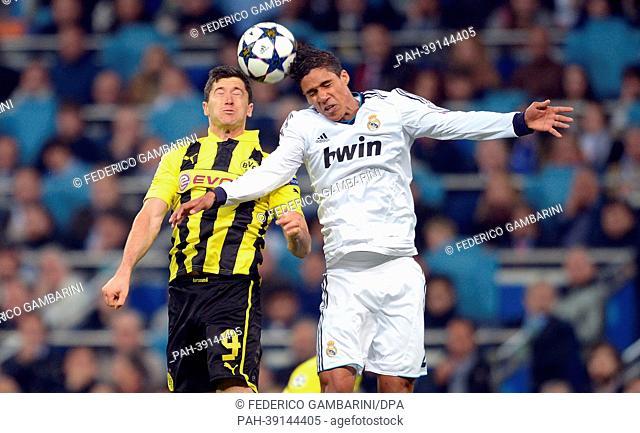 Dortmund's Robert Lewandowski (L) and Real's Raphael Varane vie for the ball during the UEFA Champions League semi final second leg soccer match between...