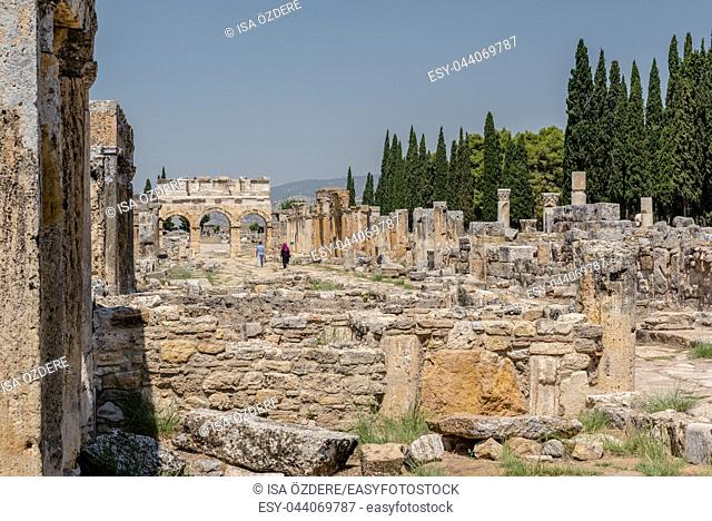 People visit latrine along Frontinus Street at Hierapolis ancient city in Pamukkale, Turkey