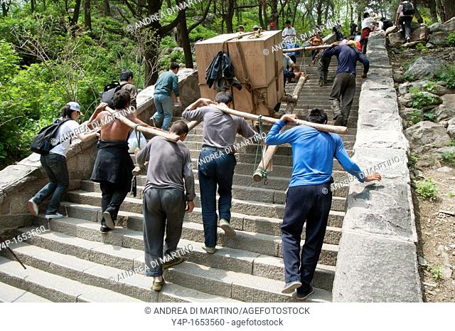 A group of workers on the way up the sacred mount Tai, Taishan, China