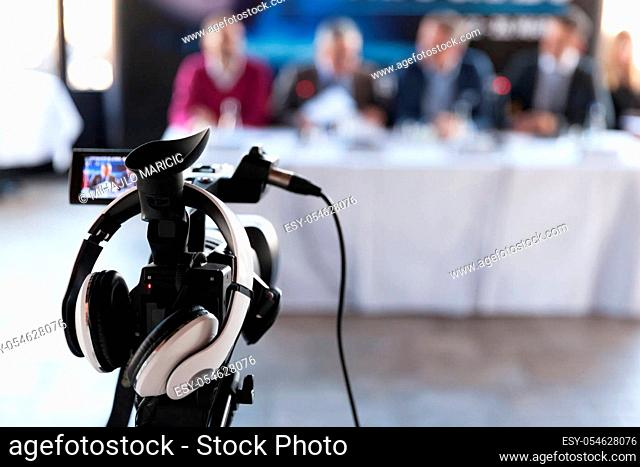 Press conference. Filming an event with a video camera