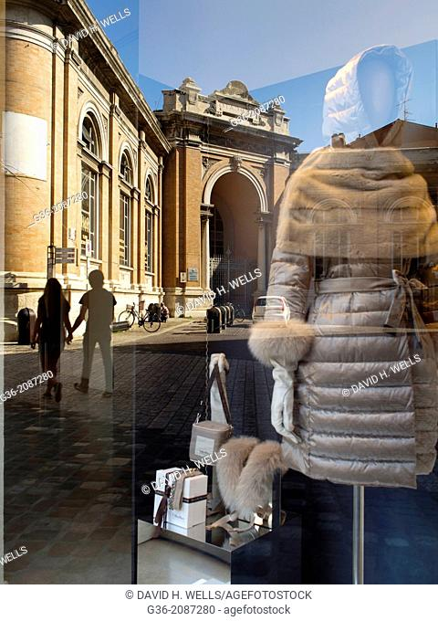 Window display of clothes store, building and street scene in background in Ravenna, Ravenna, Italy