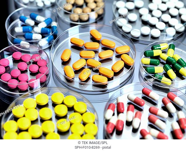 A variety of drugs in petri dishes awaiting drug testing in a lab
