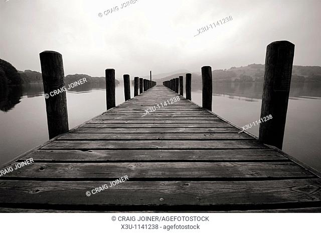 Jetty on Coniston Water in The Lake District National Park Cumbria England