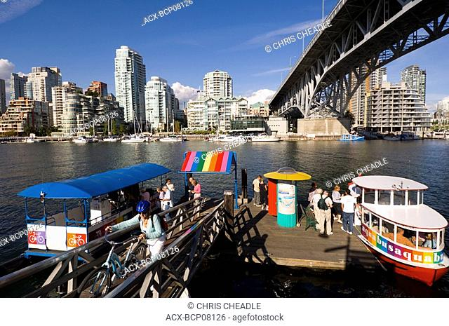 Brightly colored water taxis on False Creek, Vancouver, British Columbia, Canada