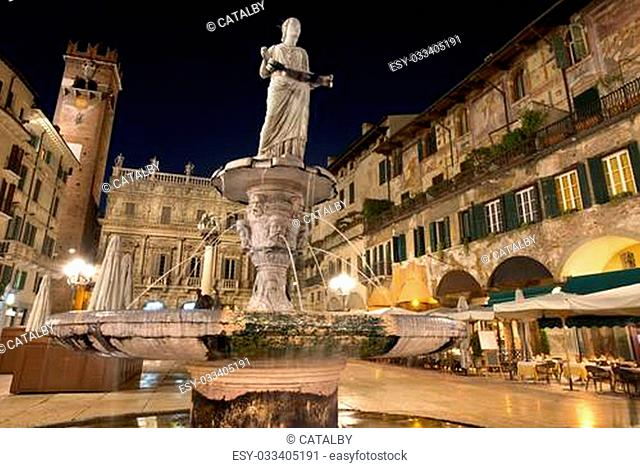 Piazza delle Erbe at night, in the foreground the statue of Madonna Verona - Italy
