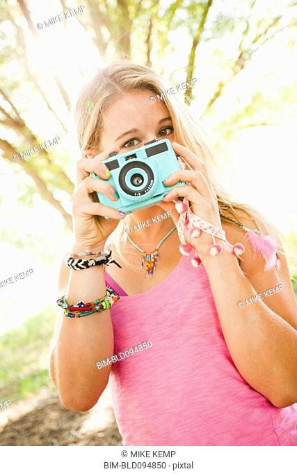 Caucasian woman taking photographs