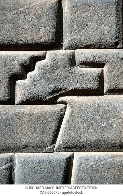 Peru, Cuzco, a 14 sided stone perfectly fitted into an old Inca wall