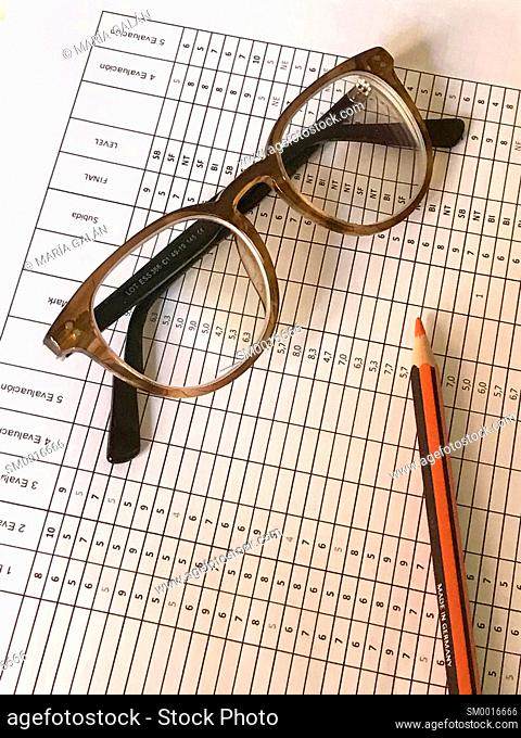 Marks report, red pencil and eyeglasses