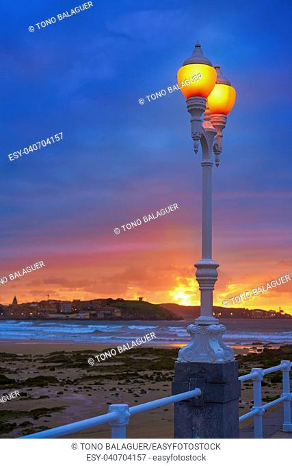 Gijon skyline sunset in San Lorenzo beach of Asturias in Spain