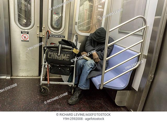 A homeless individual sleeps on the subway in New York. New York Mayor Bill de Blasio in response to criticism of his handling of the homeless problem has...