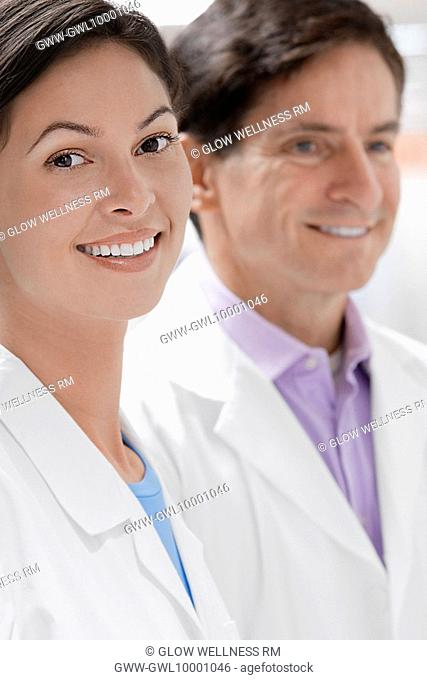 Close-up of two doctors smiling in a laboratory