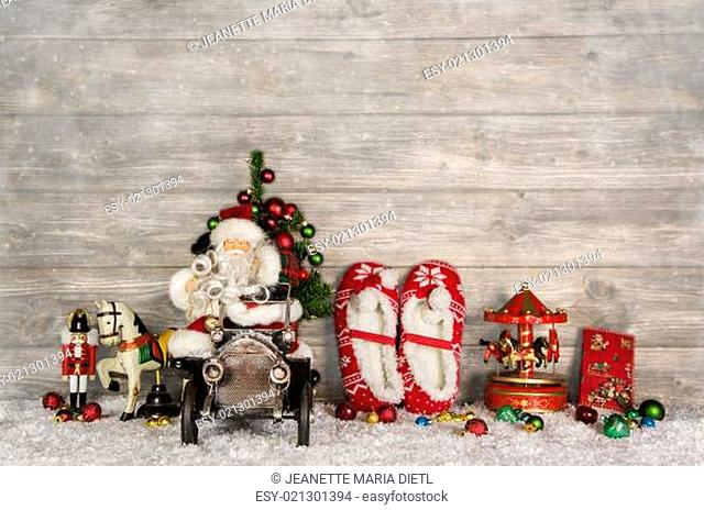 Funny christmas greeting card with santa and old children toys on wooden background